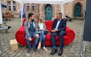Die Gelegenheit zum Gespräch auf dem Roten Sofa nutzten sowohl Bürger*innen als auch Ladenbetreiber*innen.