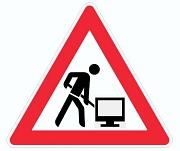Baustellenzeichen mit PC-Monitor