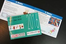 Das Programmheft für die Monate September bis Dezember 2016, ein Helft liegt mit der Umschlagseite auf einem aufgeschlagenen Exemplar.©Universitätsstadt Marburg