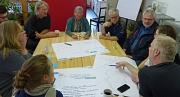 Diskutieren auf Augenhöhe: In Kleingruppen setzten sich die Teilnehmenden des ersten Workshops mit unterschiedlichen Fragestellungen auseinander.