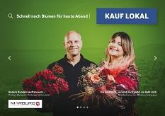 Thomas Hilberg vom Marburger Gartencenter (l.) und Anna Kochanow von kochanow.boutanique (r.) auf dem Plakat der Kauf lokal Kampagne.©Universitätsstadt Marburg