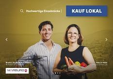 Moritz Petri von myregalbrett (l.) und Sonja Krause von Kaufs lose (r.) auf dem Plakat der Kauf lokal Kampagne.©Universitätsstadt Marburg
