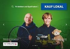 Hans-Michael Schneider von Velociped (l.) und Florian Sulzer von Spielwaren Sulzer (r.) auf dem Plakat der Kampagne Kauf lokal.©Universitätsstadt Marburg