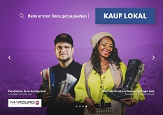 Lucas Wahl von LuckiLucki (l.) und Anwara Kleine von Anwara Moden (r.) auf dem Plakat der Kauf lokal Kampagne.©Universitätsstadt Marburg