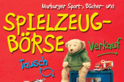 Ein Ausschnitt des Plakats zur Spielzeugbörse, ein Teddy sitzt auf einer Spielzeugküche.